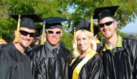 Four Crafton Hills College students in graduation attire.