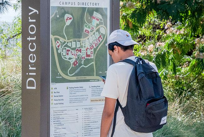 A new student viewing a map of the campus