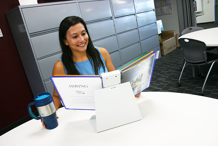Woman looking through career book