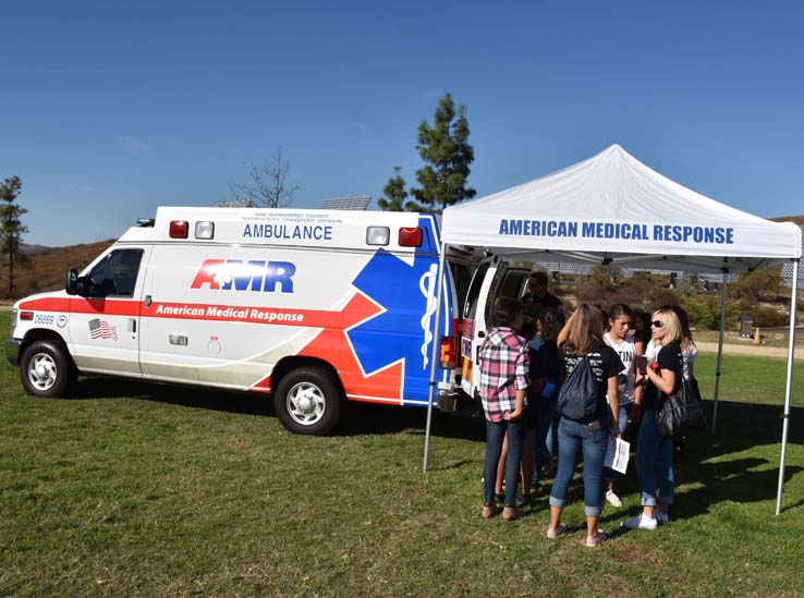 Ambulance and people at Allied Health and Medical Careers day