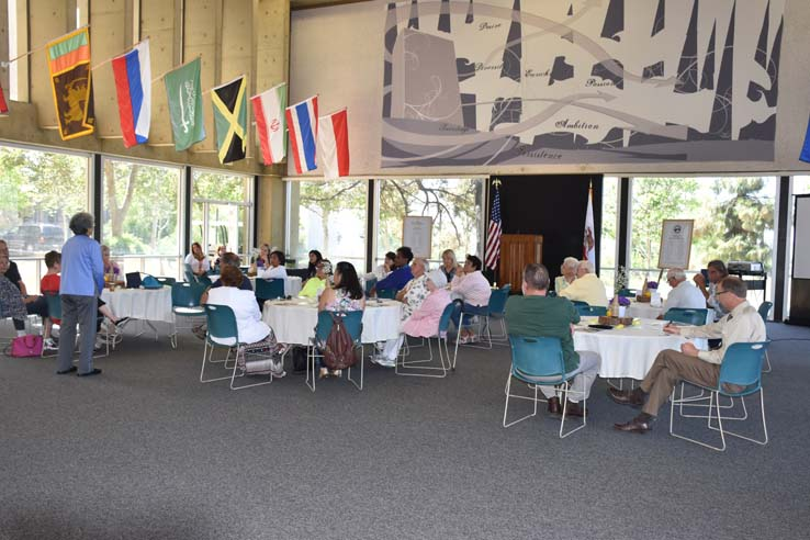 People enjoying the retiree brunch and campus tour