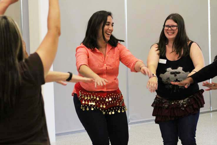 Staff practicing belly dancing