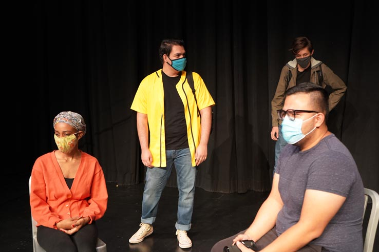 Theatre students wearing protective masks