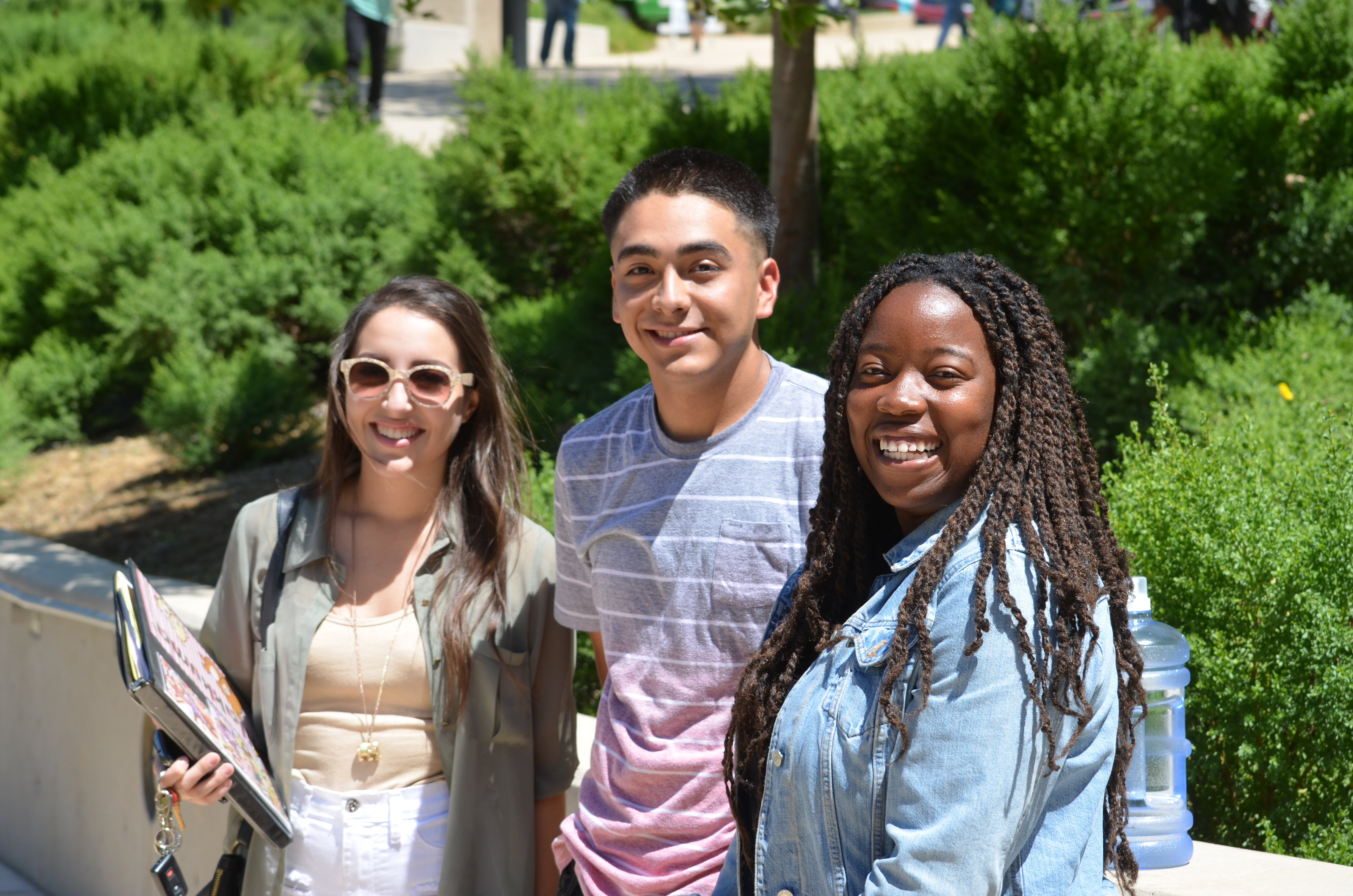 Three Crafton Hills College students smiling