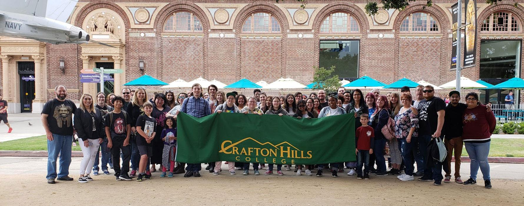 Students in front of exhibit holding Crafton Hills College Banner