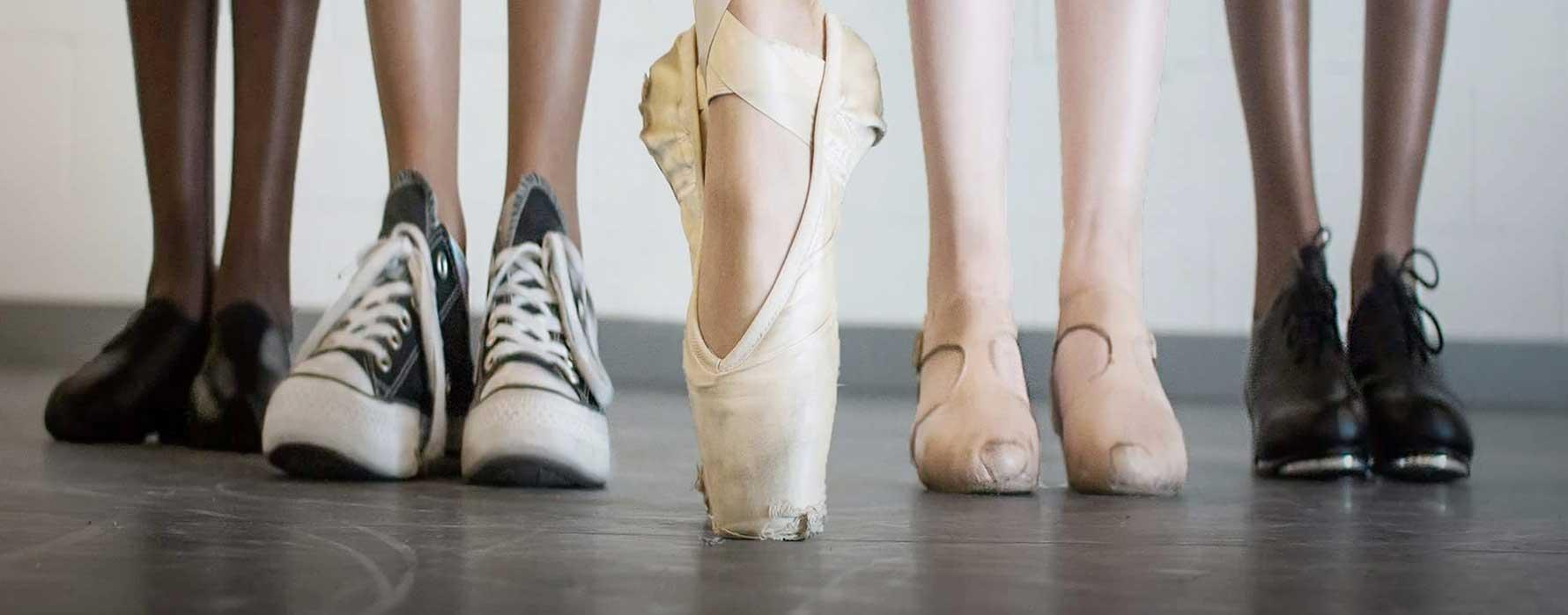 Group of feet in dance shoes