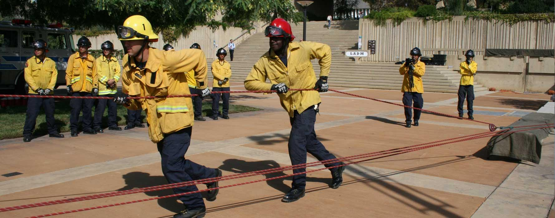 Fire Academy students pulling a rope