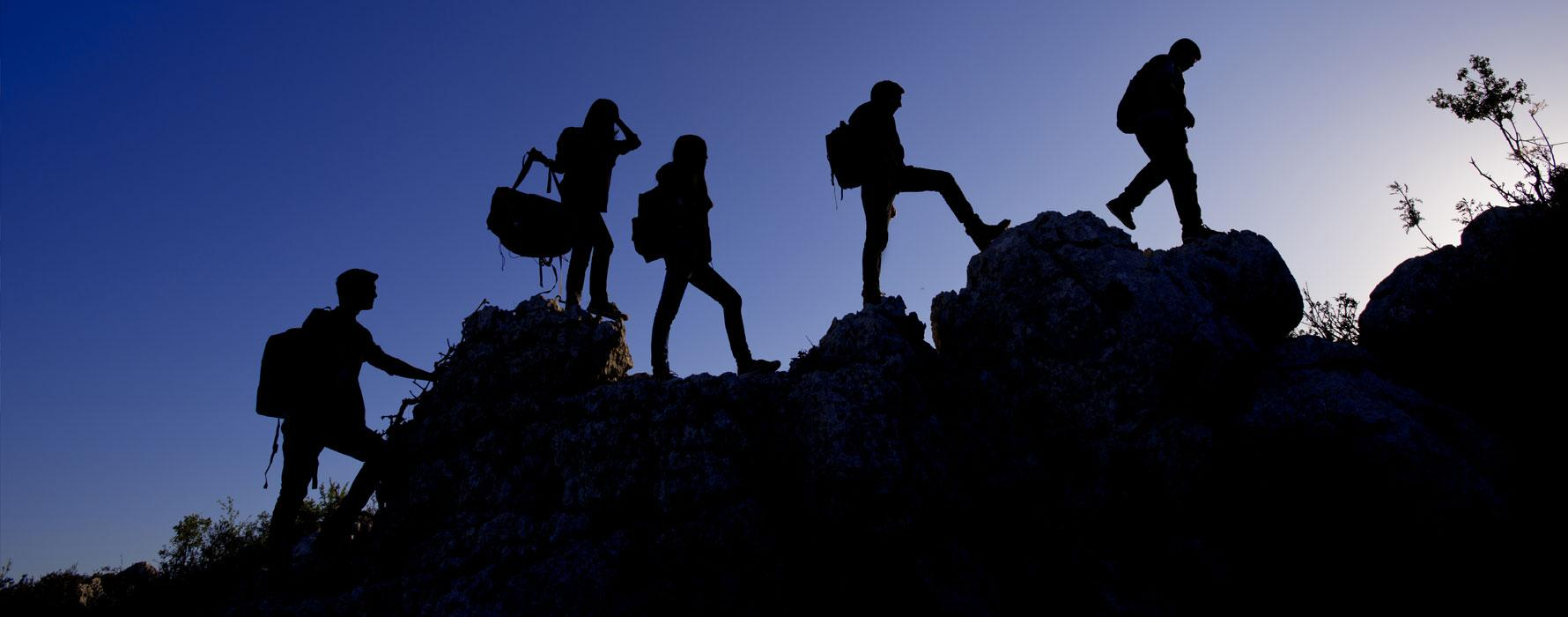 Hikers on a ridge in silhouette