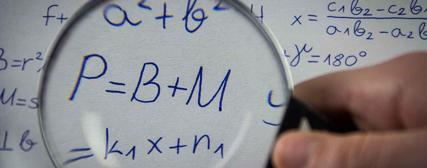 Magnifying glass over math problems