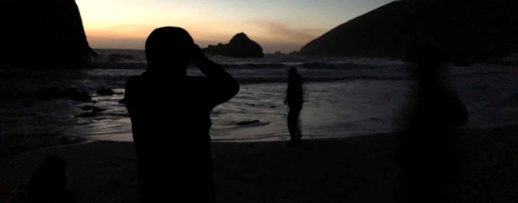 Students at ocean at sunset