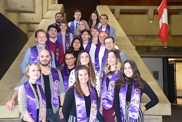 Honors graduates on stairs