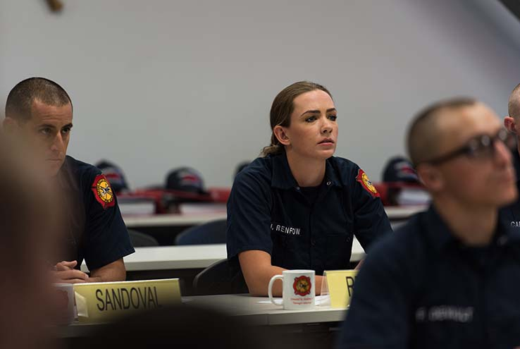 Female student in firefighter training class
