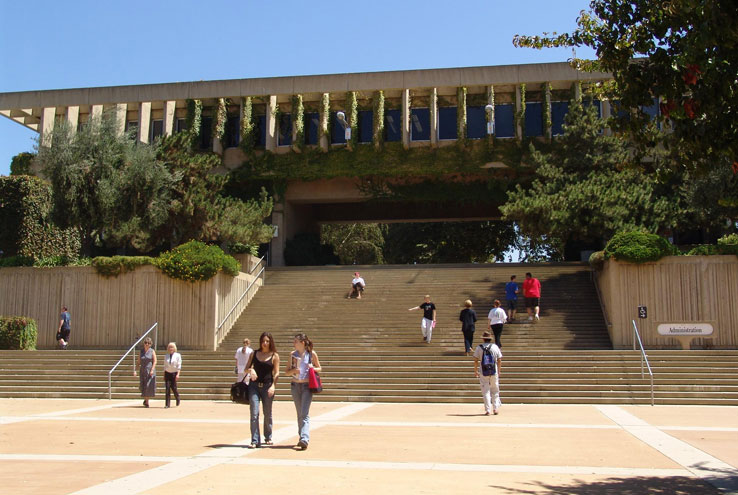 Students walking up and down a large set of stairs.