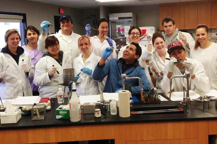 A group of students in lab coats.