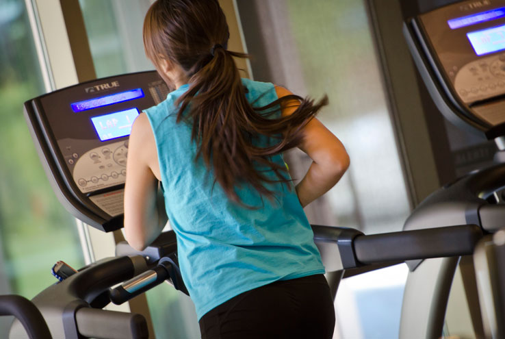 A person exercising on a treadmill.