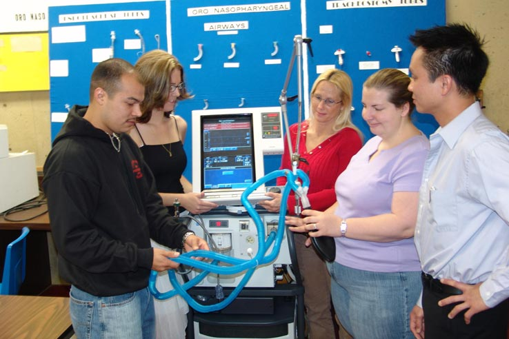Students interacting with medical equipment