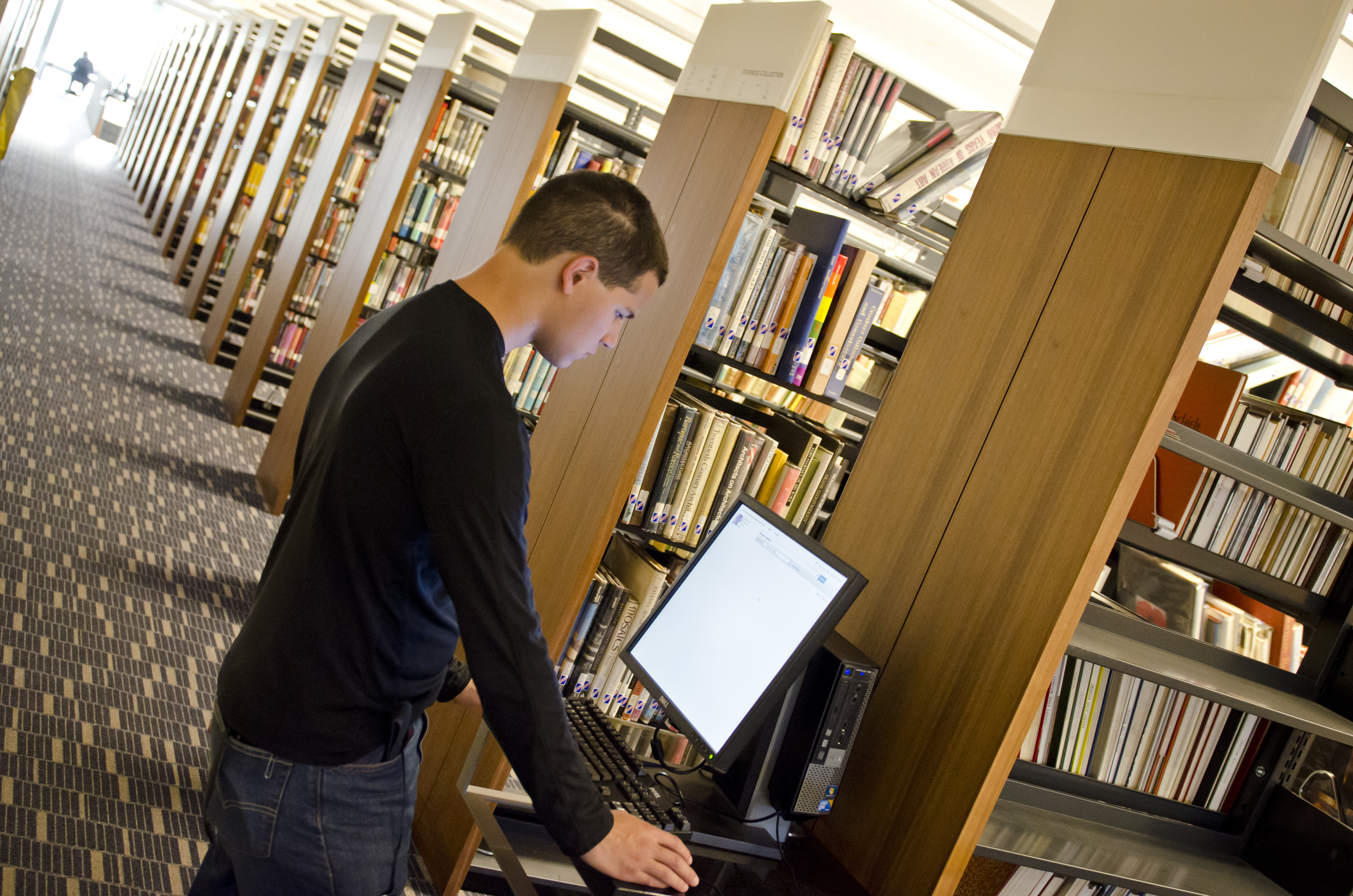 A student using a computer in the library.