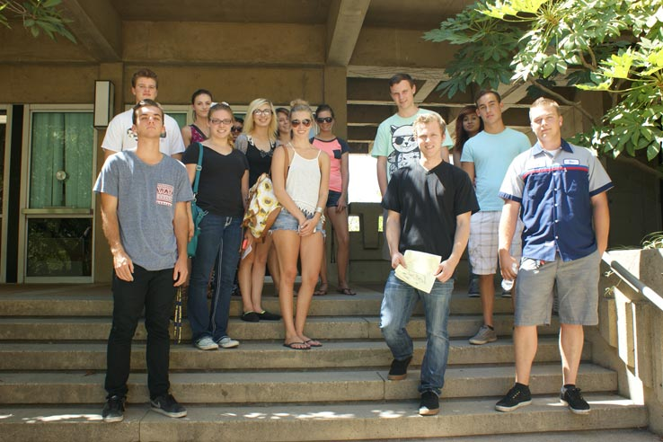 A large group of students standing on a stairway.