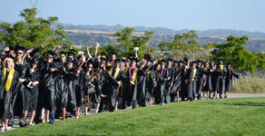 A graduating class of Crafton Hills College in their graduation attire.